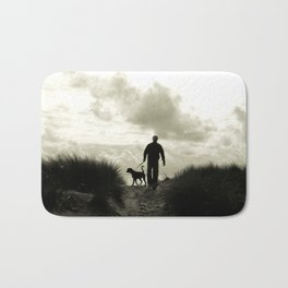One man and his dog Bath Mat