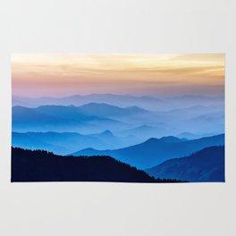 Misty mountains at dusk Rug