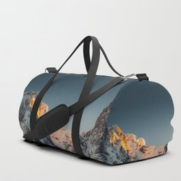 Last light before sunset on mountains Duffle Bag