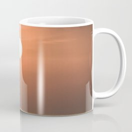 Red sunset in the ocean Coffee Mug