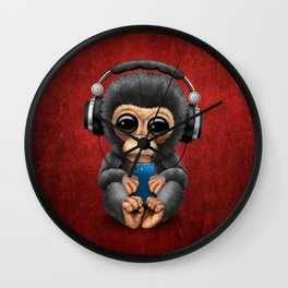 Baby Chimpanzee with Headphones Holding a Cell Phone on Red Wall Clock