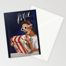 Woman putting on lipstick Stationery Cards