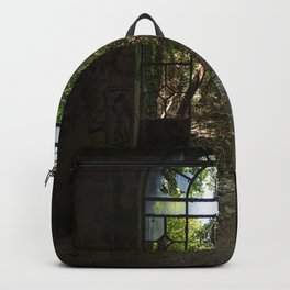 Arched door with broken windows in an old dilapidated Italian building Backpack