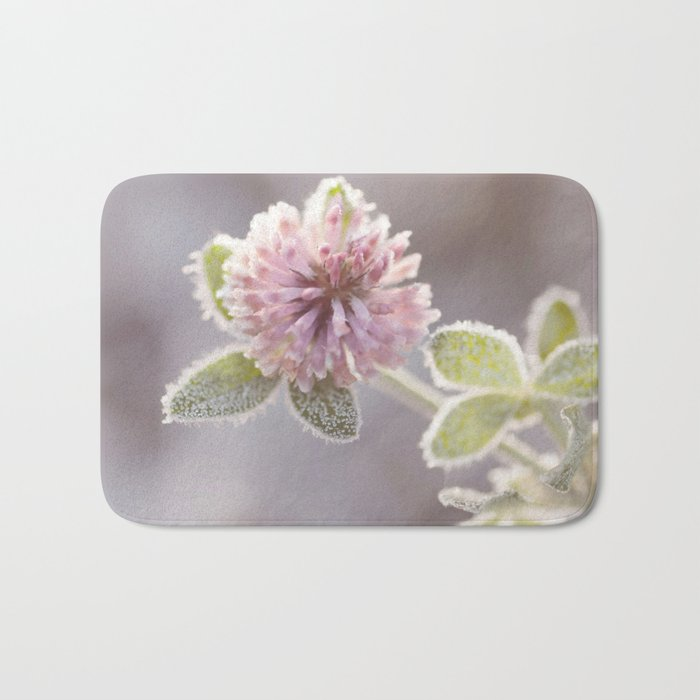 Blooming clover covered with first hoarfrost Bath Mat