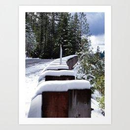 Snow on tops of guard rail posts Art Print