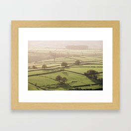 Hazy light at sunset over a valley of fields. Derbyshire, UK. Framed Art Print