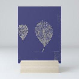 White skeleton leaves on purple Mini Art Print