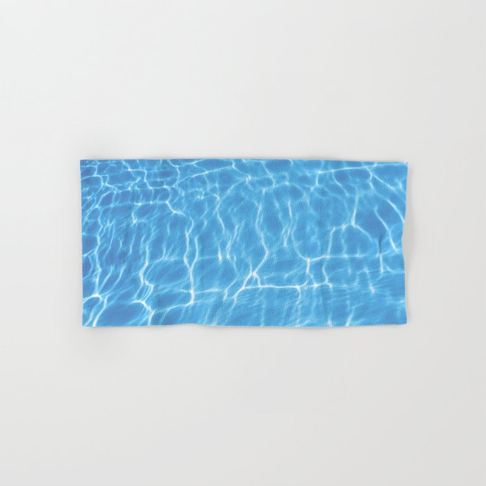 Blue ripped water in swimming pool background Hand & Bath Towel by  allexxandarx