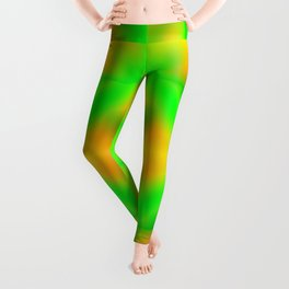 Bright pattern of blurry yellow and green flowers in a vintage kaleidoscope. Leggings