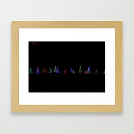 Illuminated Christmas Trees at Night Framed Art Print