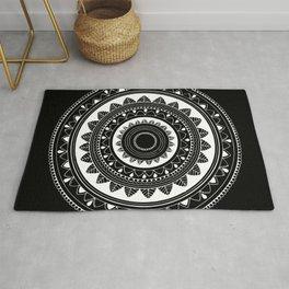 Ukatasana white mandala on black Rug