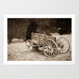 Old Wild West wagon abandoned in a meadow Art Print