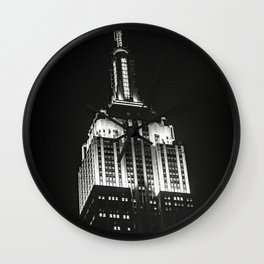 Dramatic Empire State Building in New York City at night Wall Clock