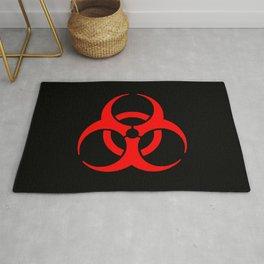 Red Bio Hazard Warning Symbol on Black Rug