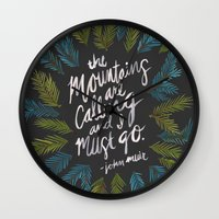 the mountains are calling Wall Clocks featuring Mountains Calling – Charcoal by Cat Coquillette