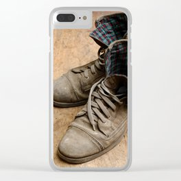 Pair of old leather shoes, worn-out and dusty, on wooden background Clear iPhone Case