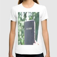 bible T-shirts featuring Holy Bible w/ bokeh by Hannah Chapman