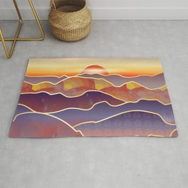 Golden sunset over rolling hills and mountains Rug
