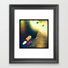 Swim towards the light little fishies. Framed Art Print