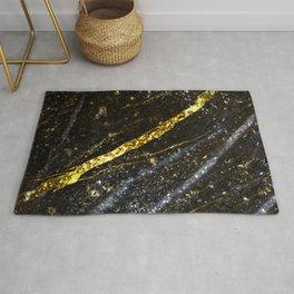 Gold sparkly line on black rock Rug
