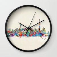 hong kong Wall Clocks featuring Hong Kong skyline by bri.buckley
