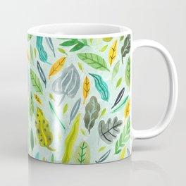 Leaves floating in the water Coffee Mug