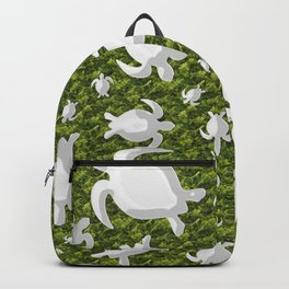 Grey turtle shapes with green nature background Backpack
