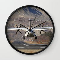 aviation Wall Clocks featuring ATR ATR-42-500 Aviation Scenic Dangerous No way out Landing aircraft by Aviator