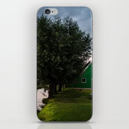 Green cottage at summer sunset iPhone Skin