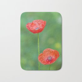 Two wet red poppies Bath Mat