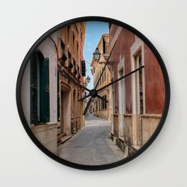 Narrow street in Ciutadella with old houses - Menorca, Spain Wall Clock