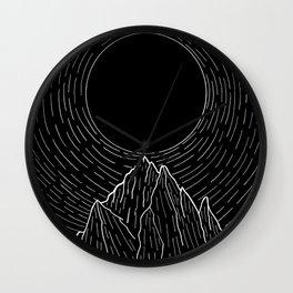 The dark sun over the mountains Wall Clock