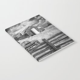 Black and White of Rusted International Harvester Pickup Truck behind wooden fence with Red Barn in Notebook