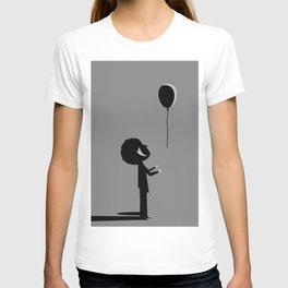 boy letting out a ballon T-shirt