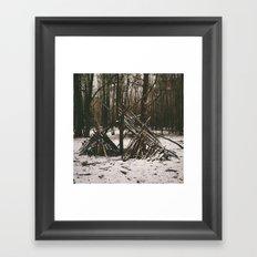 Shelter in snowy woodland. Norfolk, UK. Framed Art Print