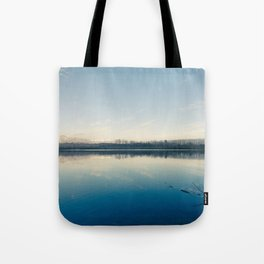 A blue  winter lake Tote Bag