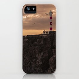 The Lighthouse guarding the coast. iPhone Case