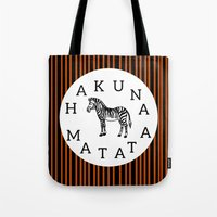 hakuna Tote Bags featuring Hakuna Matata  by Shelby Thompson