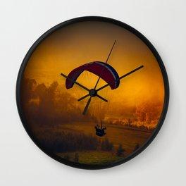 Paraglider Flying Around Orange Clouds Wall Clock