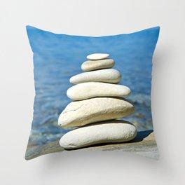 Pyramid of stones in sea shore Throw Pillow