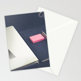 A notebook with letter a on a dark table Stationery Cards