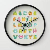 alphabet Wall Clocks featuring alphabet by lalehan canuyar