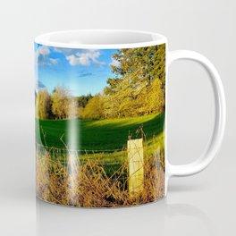 Golden Evening Light Across A Field Coffee Mug
