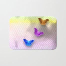 Rainbow of butterflies on textured chevron pattern Bath Mat