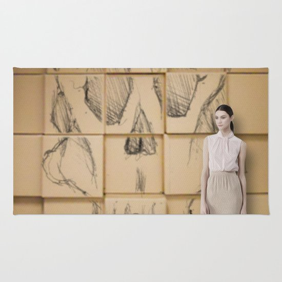Space in Boxes with a model Rug