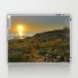 Sunset at the beach. White flowers on the sand Laptop & iPad Skin