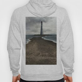 Cloudy seascape with an older lighthouse Hoody