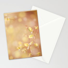 Many young spring leaves on blurred background Stationery Cards