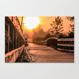 A beautiful sunrise view from a park footbridge Canvas Print