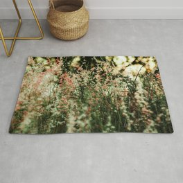 Flowers in the sun Rug